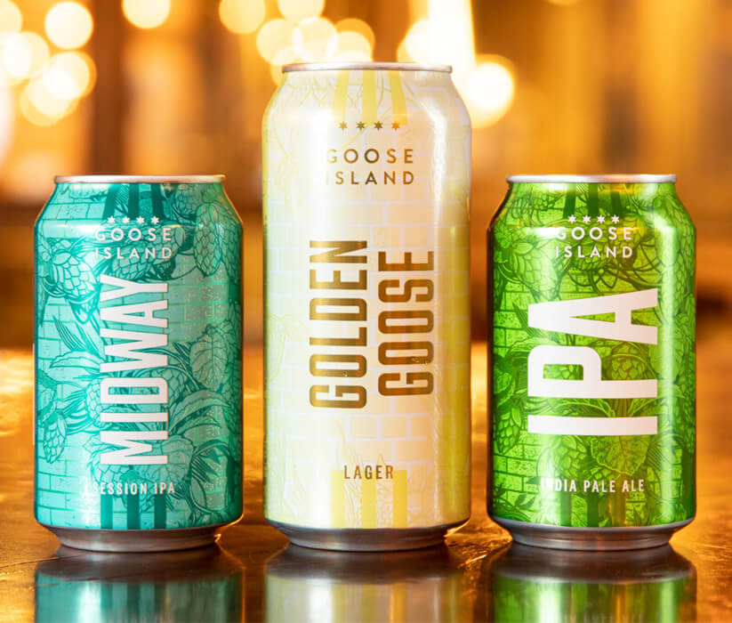 Three different cans of Goose Island Craft Beers