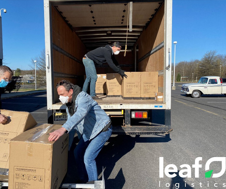 Men loading boxes out of a box truck