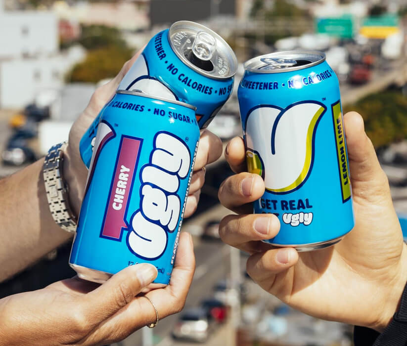 Three different cans of Ugly beverages
